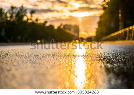 Sun after the rain in the city, the view from the road level - stock photo