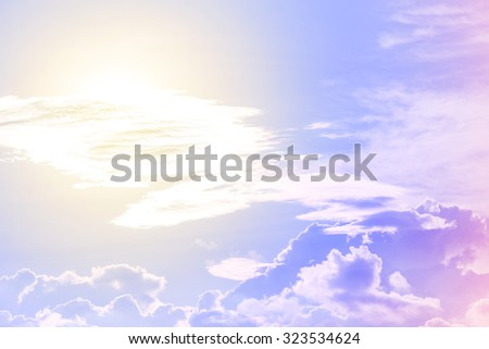 sun and cloud background with a pastel violet colored gradient. - stock photo