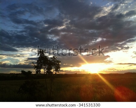 Sun and clouds at sunset - stock photo