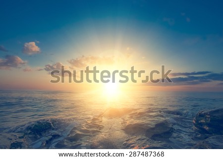 Sun and clouds over the sea - stock photo