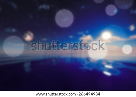 sun and moon over island blurred background - stock photo