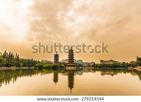 Sun and Moon Twin Pagodas at dusk in Guilin, China - stock photo