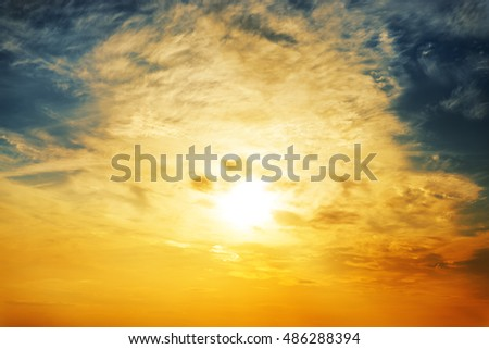 sun and orange clouds in sunset