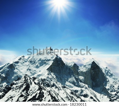 Sun and snow in mountains