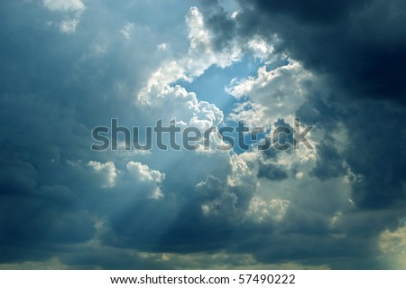 Sun are striking through the clouds - stock photo