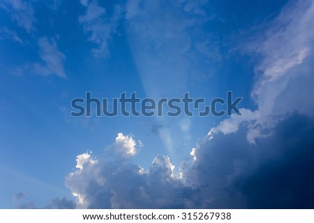sun beam in blue sky with clouds background - stock photo