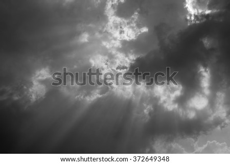 Sun beam with fluffy clouds