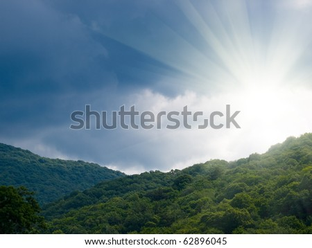 sun beams forest and rocks summer landscape - stock photo
