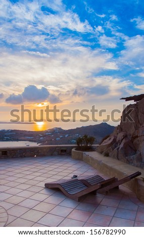 Sun beds in the courtyard at sunset Mediterranean. - stock photo
