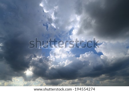 Sun behind clouds - stock photo