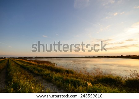sun behind the clouds on a cold day, nature series - stock photo