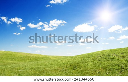 sun, blue sky and green grass - stock photo