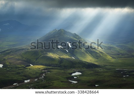 Sun breaking through the clouds on a mountain on the Laugavegur hiking trail on Iceland.