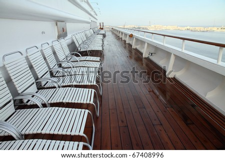 Sun chairs on a cruise deck Maditerranean sea - stock photo