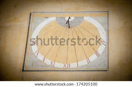 Sun clock on a wall of the City hall in the medieval town Entrevaux (Alpes de Haute Provence, France). Shadowed angles. - stock photo