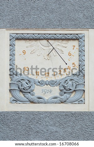 Sun dial on a wall of an old castle in Hluboka nad Vltavou, Czech Republic - stock photo