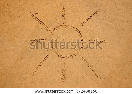 Sun Drawn in the Sand on a Beach  - stock photo