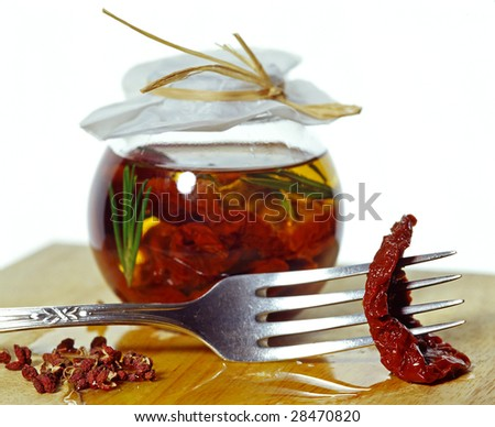 sun dried tomatoes in jar - stock photo