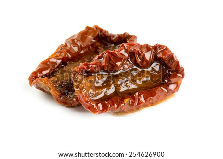 sun dried tomatoes with olive oil isolated on white - stock photo