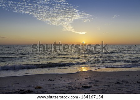 Sun going down on the beach in South Florida - stock photo
