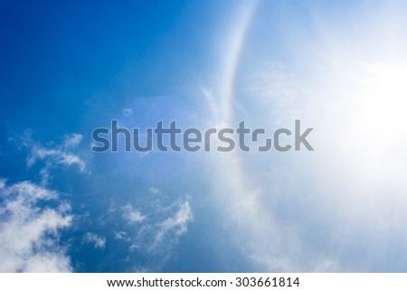 Sun halo in the sky.rainbow in sky with cloud - stock photo