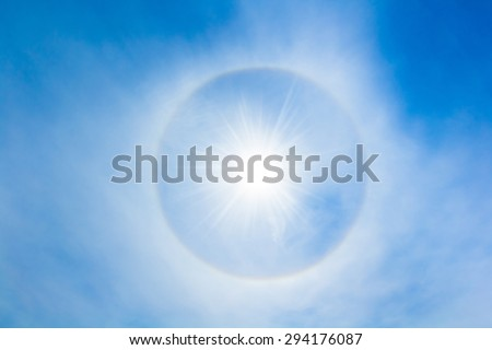 Sun halo in the sky. The sun halo is circle around the sun or the moon made from ice crystals in the sky. It is rare phenomenon
