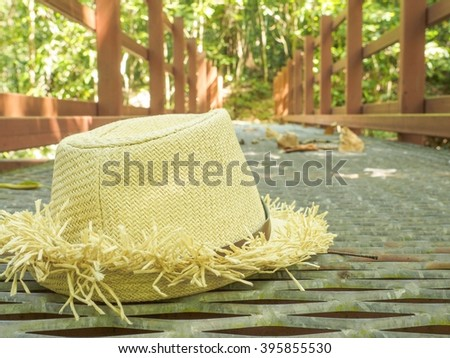 Sun hat on bridge