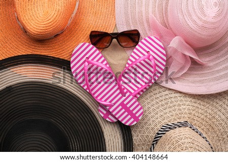 Sun hat, sunglasses and flip-flops, beach accessories, beach fashion