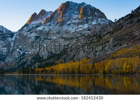 Sun hitting the Carson Peak by Silver Lake in Autumn, Eastern Sierra - stock photo