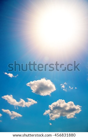 sun in a bright blue sky. Nature composition. - stock photo