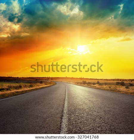 sun in clouds over road - stock photo