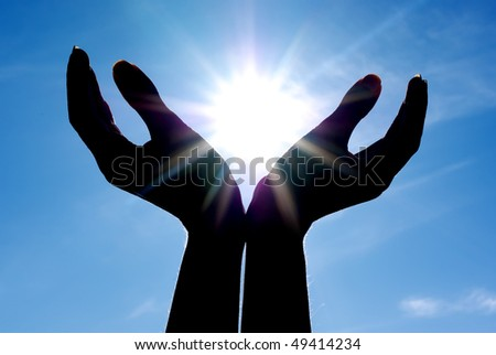 Sun in hands. Conceptual design. - stock photo