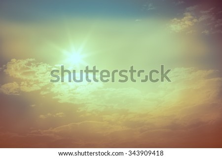 sun in the blue sky, vintage style - stock photo