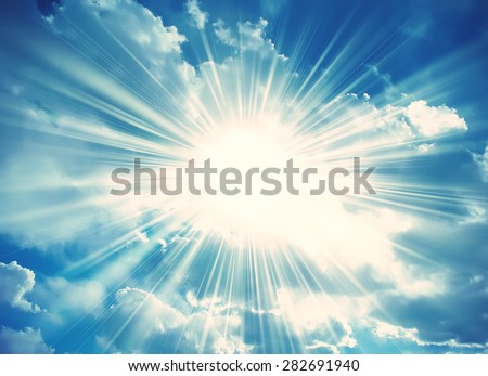 Sun in the blue sky with clouds. Brightly sunlight. Sunny day. Freedom solar concept - stock photo