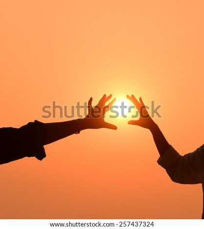 Sun in the hands on the sky - stock photo