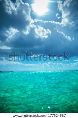 sun in the sky and beautiful waters of the caribbean sea near the saona island