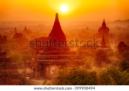 Sun is rising over old pagodas of an ancient city of Bagan, Myanmar - stock photo