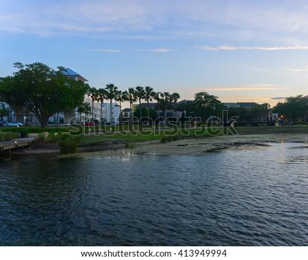 Sun is setting at a community/Orlando Florida/Evening at Lake Baldwin  - stock photo