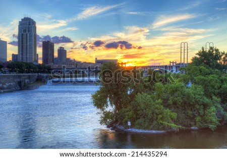 Sun is setting over Mississippi River, in Minneapolis. - stock photo