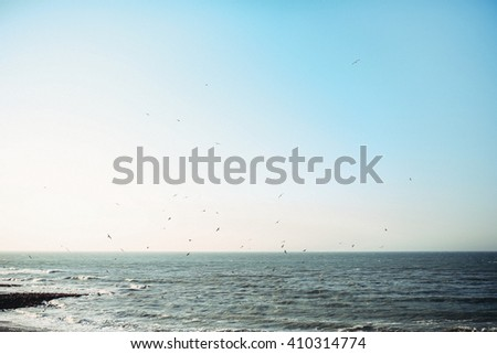 sun is shining above the seashore - stock photo