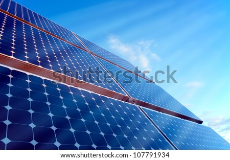 Sun is shining onto a solar panel