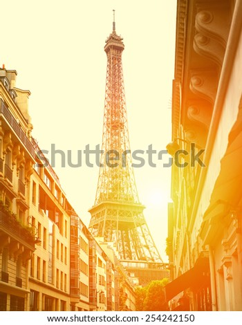 Sun light on the street with view on the Eiffel Tower - stock photo