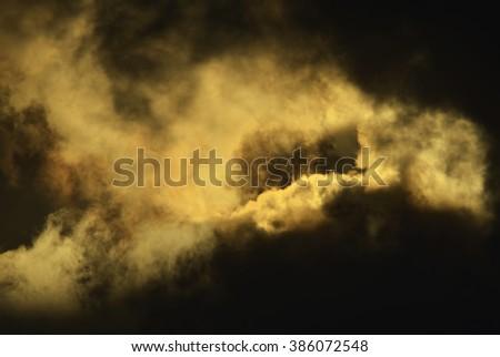 Sun light shining through the dark cloud - stock photo