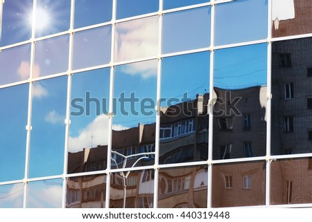 sun light sky cloud reflection in glass office building  - stock photo