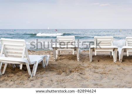 Sun loungers at Mediterranean beach, Alicante, Spain