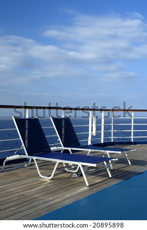 Sun loungers on the deck - stock photo