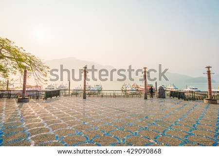 Sun Moon Lake, Yuchi, Nantou county, Taiwan - March 21, 2015 : Sunrise View of Sun Moon Lake with the passenger boats waiting at the numerous piers