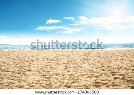 sun of summer time on sky and sand of beach  - stock photo