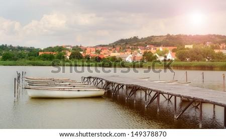 Sun on a summer Balaton boat dock at sunrise - stock photo