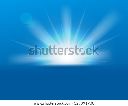 Sun on blue background with copy space. - stock photo